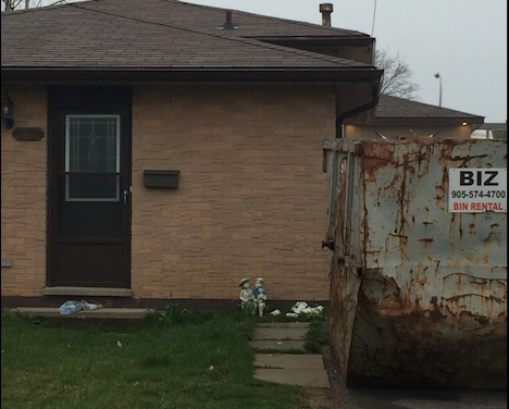 Ugly dumpster in driveway